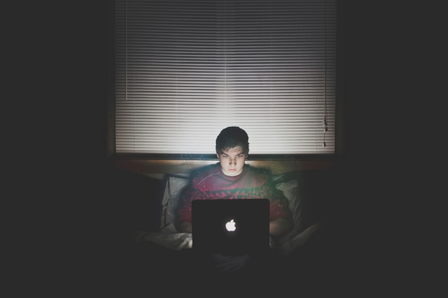 Young Man Watching a Service on His Laptop