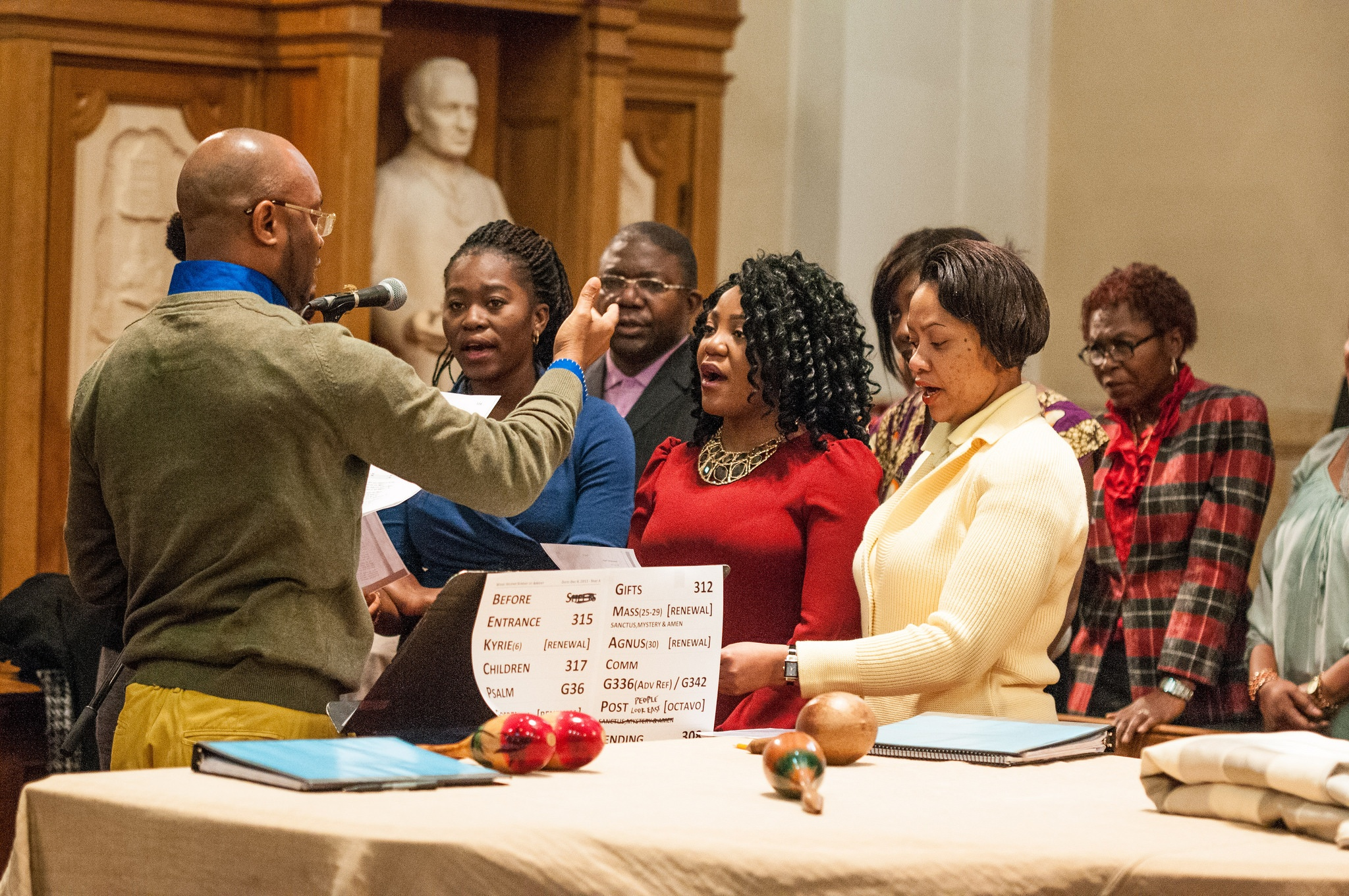 A worship leader leads the choir