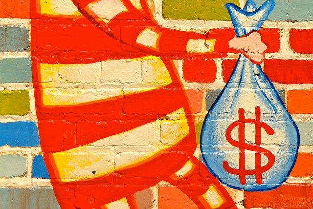 Image: Colorful wall mural of a person holding a bag of money