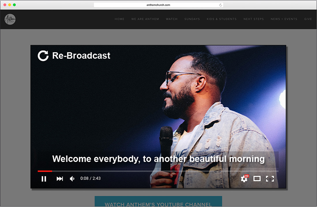 Browser window showing a rebroadcast live stream. A man is welcoming everybody to the event.